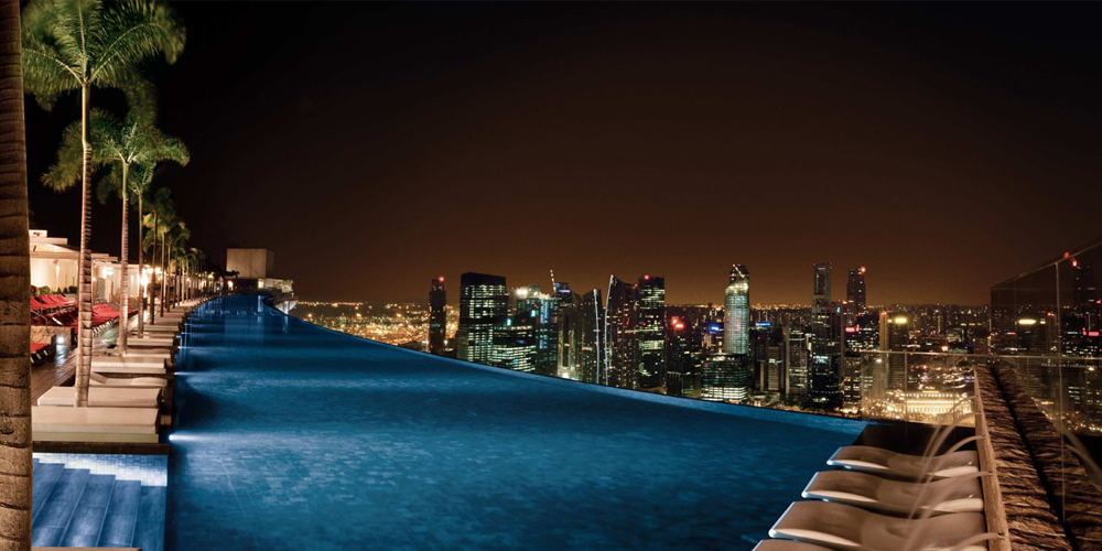 La piscina infinita ad alta quota ecco il marina bay sands hotel di singapore coolture hunter - Singapore hotel piscina ...